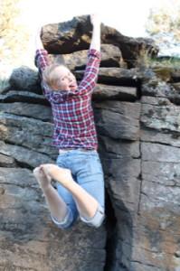 ari climbing rock